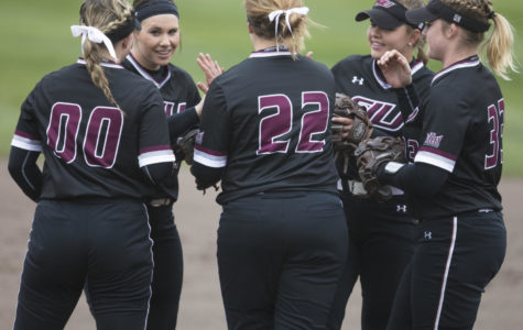 SIU Softball members give each other encouragement before the start of the game Sunday, March 25, 2018, during the Blackout Cancer game, where the Salukis took a 6-3 win against Illinois State University, at Charlotte West Stadium. (Corrin Hunt | @CorrinIHunt)