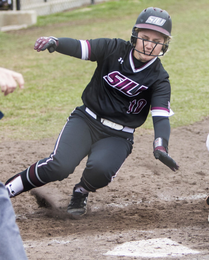 Saluki freshman Meredith Wernig reaches for home base Sunday, March 25, 2018, during the Blackout Cancer game, where the Salukis took a 6-3 win against Illinois State University, at Charlotte West Stadium. (Corrin Hunt   @CorrinIHunt)