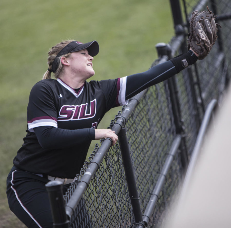 Saluki sophmore Kyleigh Decker reaches for a foul ball Sunday, March 25, 2018, during the Blackout Cancer game, where the Salukis took a 6-3 win against Illinois State University, at Charlotte West Stadium. (Corrin Hunt | @CorrinIHunt)