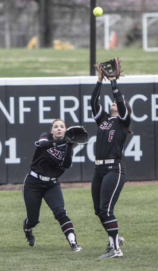 Saluki Outfielders Maris Boelens, left, and Savannah Fisher go for a catch Sunday, March 25, 2018, during the Blackout Cancer game, where the Salukis took a 6-3 win against Illinois State University, at Charlotte West Stadium. (Corrin Hunt   @CorrinIHunt)