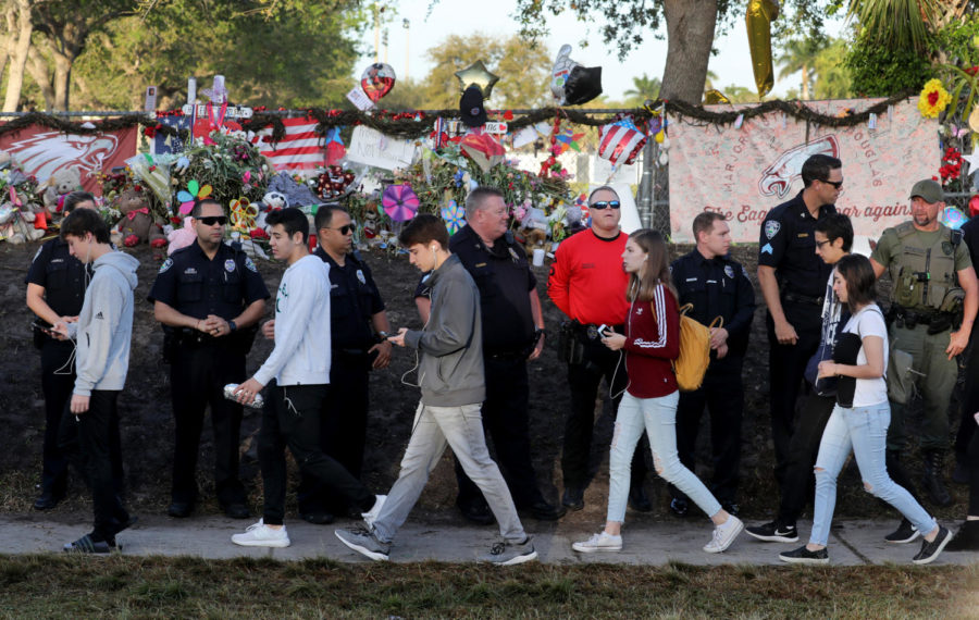 Students head back to school at Marjory Stoneman Douglas High School on Wednesday, Feb. 28, 2018 for the first time after a gunman killed 17 students in the school on Valentine's Day. (Mike Stocker/Sun Sentinel/TNS)