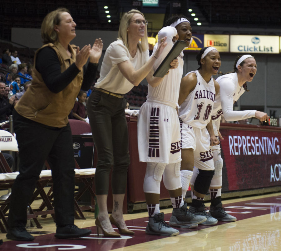Members+of+the+Saluki+women%27s+basketball+team+celebrate+after+a+basket+Thursday%2C+March+1%2C+2018%2C+during+the+Salukis%27+54-43+victory+against+the+Sycamore+at+SIU+Arena.+%28Dylan+Nelson+%7C+%40Dylan_Nelson99%29%0A%0A