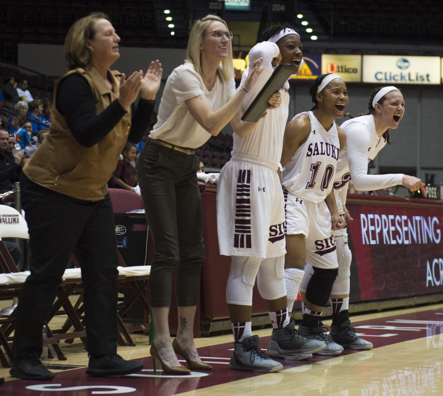 Members of the Saluki women's basketball team celebrate after a basket Thursday, March 1, 2018, during the Salukis' 54-43 victory against the Sycamore at SIU Arena. (Dylan Nelson | @Dylan_Nelson99)