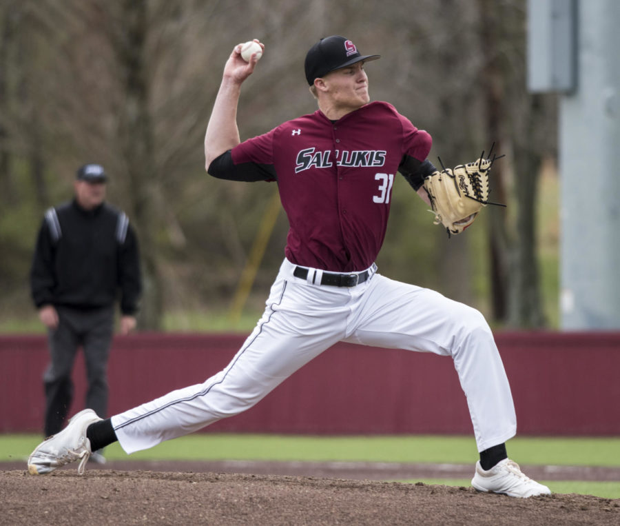 Senior Michael Baird, 31, of Parker Colo. pitches the ball, Friday, April, 6, 2018, during the Saluki's 6-2 win against Valparaiso at Itchy Jones Stadium. (Mary Newman | @MaryNewmanDE)
