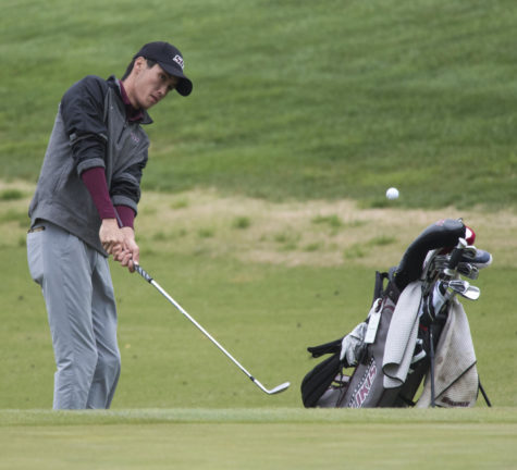 Golf coach aims high for low scores
