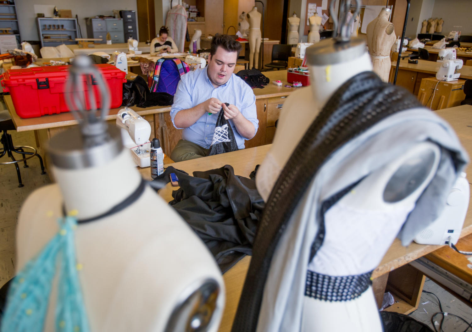 Joshua Gavel, a senior studying fashion design and merchandising from Champaign, puts together clothing for the senior design runway show Monday, April 2, 2018, in the fashion merchandising studio in Quigley Hall.