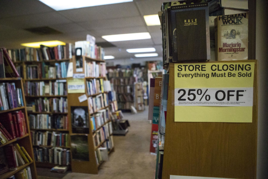 Store Closing signs are scattered across bookshelves  Friday, April 13, 2018, at the Bookworm book store in Carbondale. (Corrin Hunt   @CorrinIHunt)