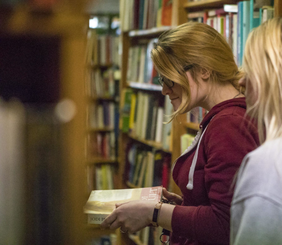 Hannah Wales, a junior studying nursing from Carbondale, looks at books Friday, April 13, 2018, Friday, April 13, 2018, at the Bookworm book store in Carbondale. Wales first started shopping at the Bookworm when she was a kid with her grandmother. (Corrin Hunt   @CorrinIHunt)