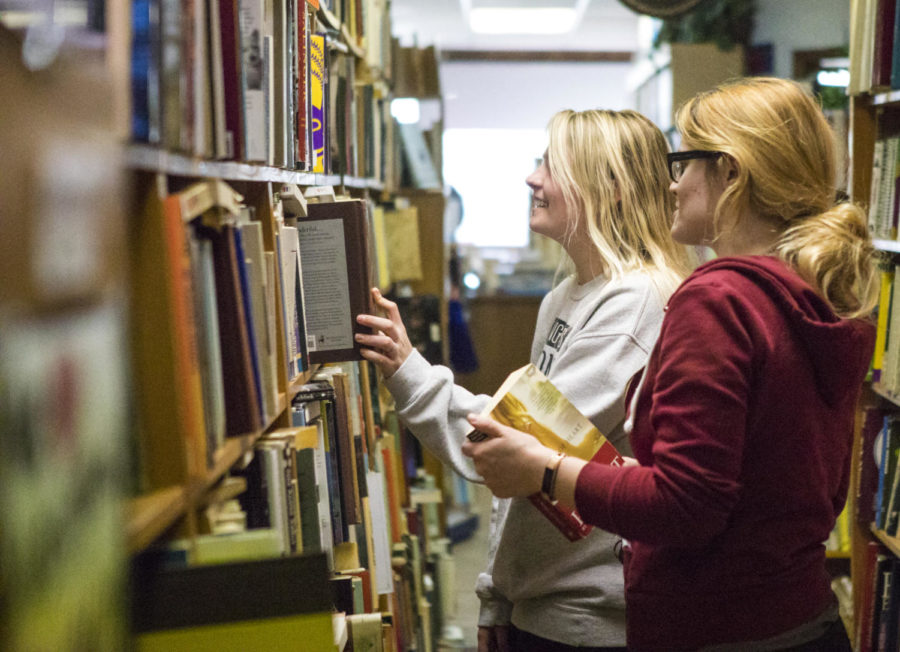Victoria Evans, a senior studying nursing from Golconda, and Hannah Wales, a junior studying nursing from Carbondale, right, look at books Friday, April 13, 2018, during the store closing sale at Bookworm in Carbondale. Wales first started shopping at the Bookworm when she was a child with her grandmother. (Corrin Hunt   @CorrinIHunt)