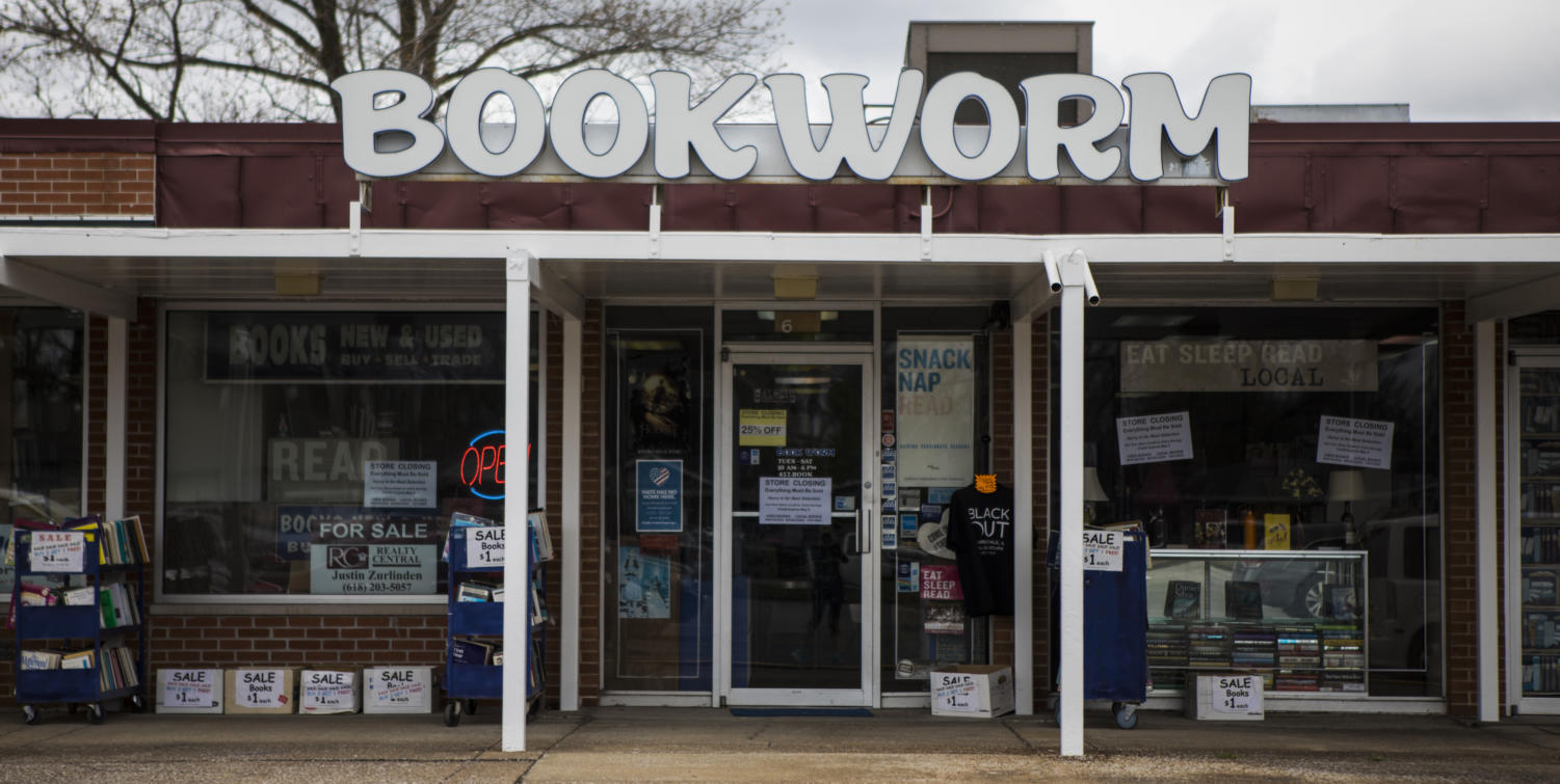 Store closing signs cover the storefront Friday, April 13, 2018, during a closing sale at Bookworm in Carbondale. (Corrin Hunt | @CorrinIHunt)
