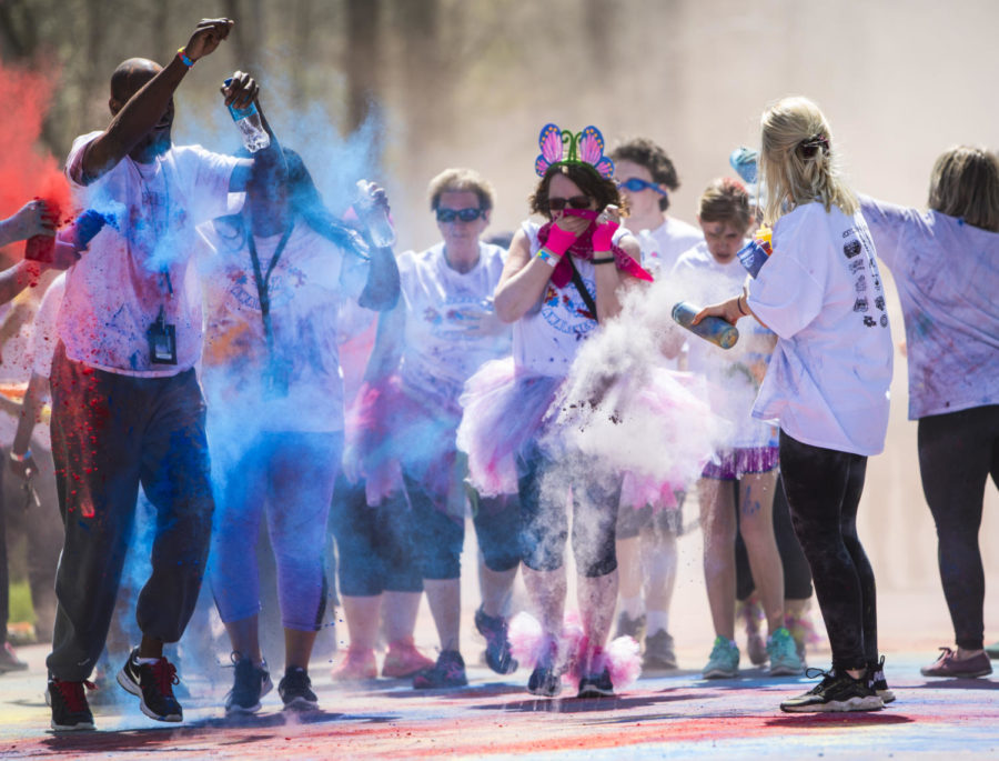 Runners go through a color station, Saturday, April 21, 2018, during the Color Fun Run for the Autism Society of Southern Illinois at Southern Illinois University. (Corrin Hunt   @CorrinIHunt)