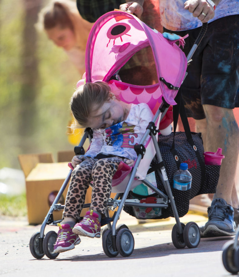 Kennedy Tilley, 3, of DuQuion, sleeps in her stroller Saturday, April 21, 2018, during the Color Fun Run for the Autism Society of Southern Illinois at Southern Illinois University. (Corrin Hunt   @CorrinIHunt)