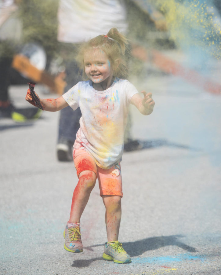 Olivia Lou Leber, 3, of Sesser, dances while throwing colored paint, Saturday, April 21, 2018, during the Color Fun Run for the Autism Society of Southern Illinois at Southern Illinois University. (Corrin Hunt   @CorrinIHunt)