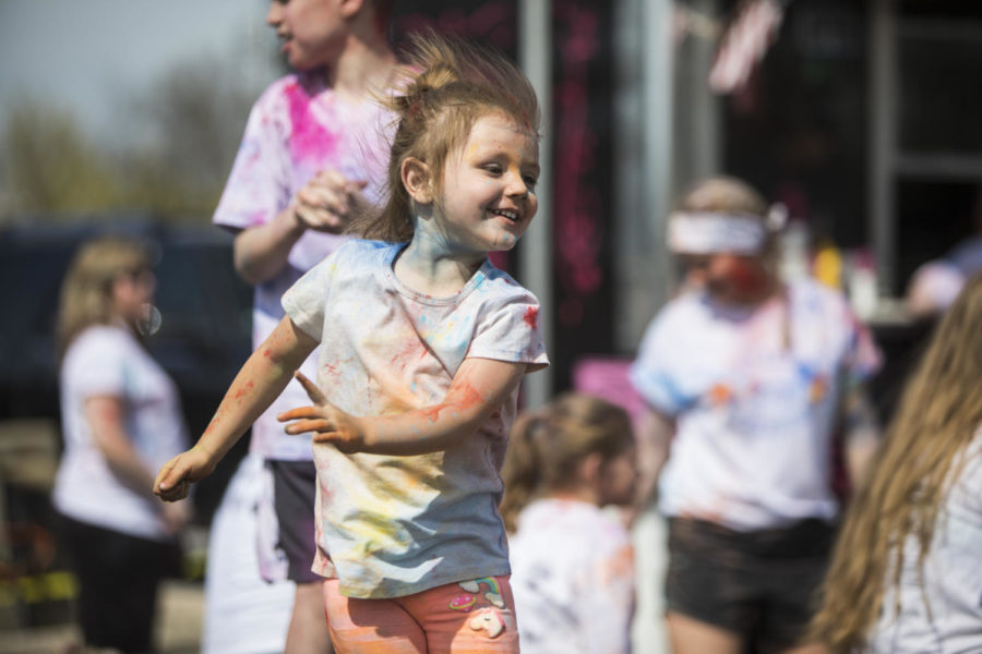 Olivia Lou Leber, 3, of Sesser, dances on stage, Saturday, April 21, 2018, during the Color Fun Run for the Autism Society of Southern Illinois at Southern Illinois University. (Corrin Hunt   @CorrinIHunt)