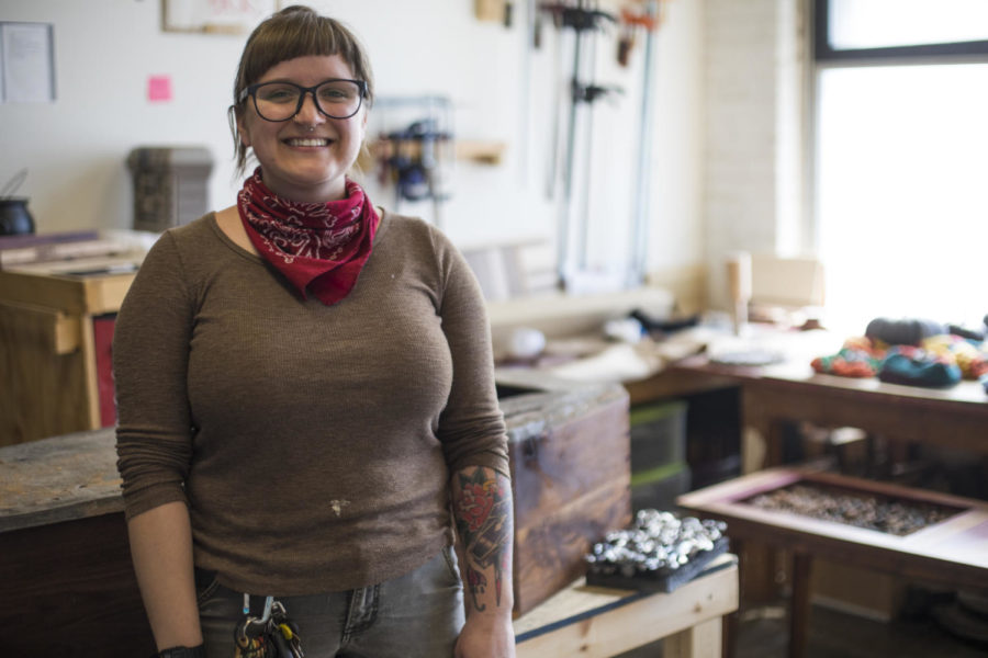 Jam Lovell, a third-year MFA candidate in sculpture from East Peoria, poses for a portrait among her sculptures, Friday, April 20, 2018, at her studio in the SIU Glove Factory. (Corrin Hunt   @CorrinIHunt)