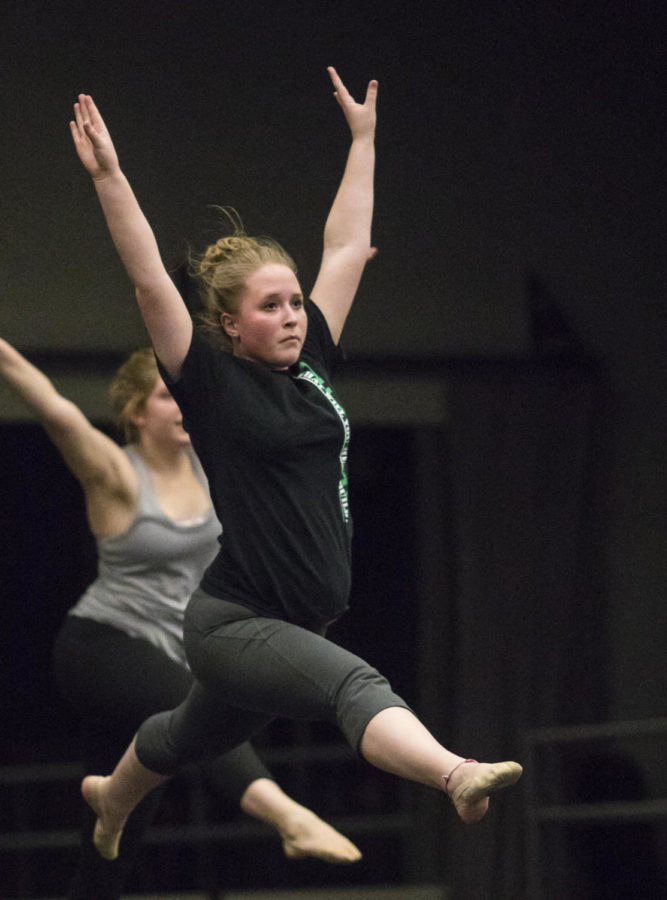 Clair Bammann, a junior studying civil engineering, jumps while practicing a dance Thursday, April 13, 2018, during a rehearsal in preparation for the SIDC Spring Concert in the Furr Auditorium. (Corrin Hunt   @CorrinIHunt)