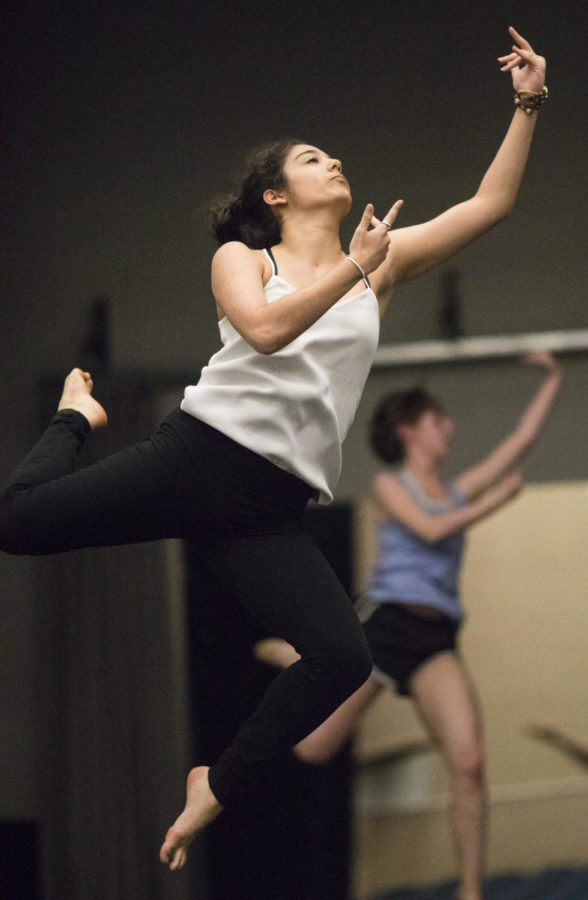 Emily Perez, a freshman studying radiology sciences, jumps while practicing dance Thursday, April 13, 2018, during a rehearsal in preparation for the SIDC Spring Concert in the Furr Auditorium. (Corrin Hunt   @CorrinIHunt)