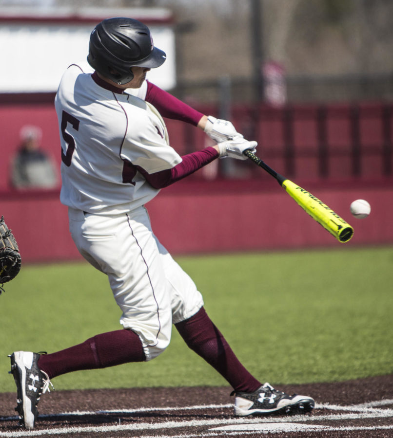 Southern Illinois freshman infielder Grey Epps makes contact with the ball, Saturday, April 7, 2018, during the Valparaiso University Crusaders 6-2 victory against the Southern Illinois Salukis at Itchy Jones Stadium. (Corrin Hunt   @CorrinIHunt)