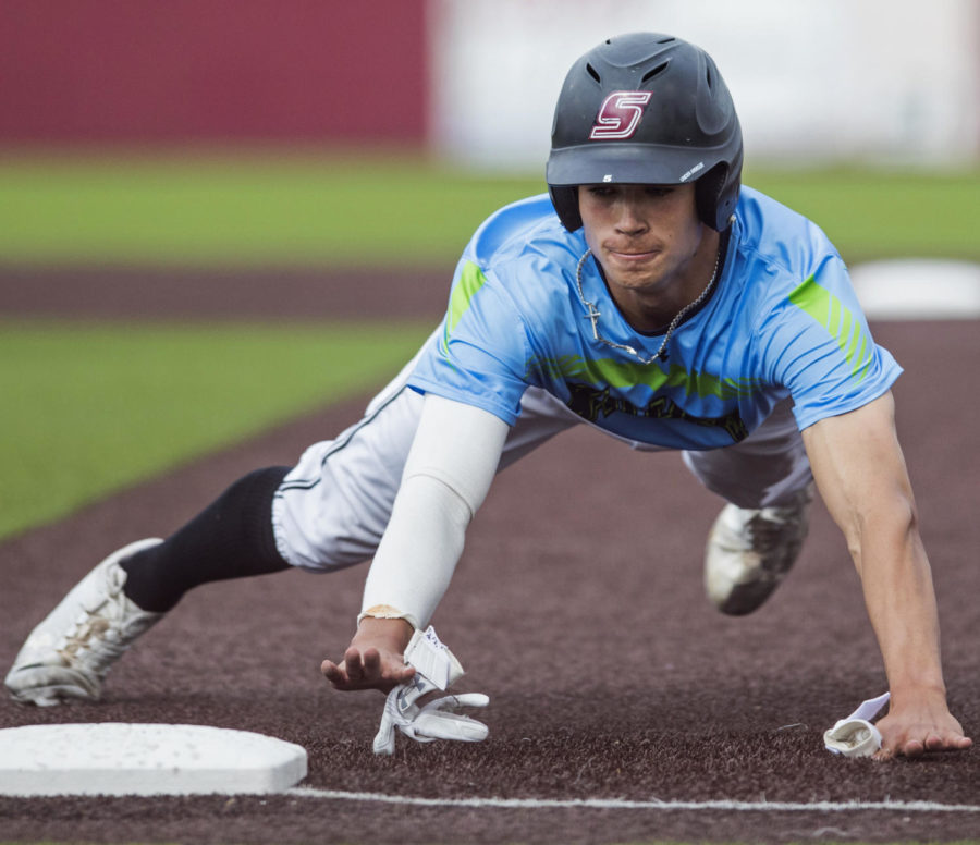 Southern Illinois infielder Grey Epps (5) slides into first base, Tuesday, April 24, 2018, during the Southern Illinois Salukis 2-0 victory against the Southeast Missouri Redhawks at Itchy Jones Stadium. (Corrin Hunt | @CorrinIHunt)