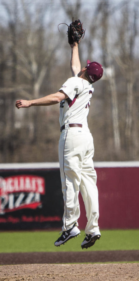 Southern Illinois senior Jamison Steege (32) jumps to catch the ball, Saturday, April 7, 2018, during the Valparaiso University Crusaders 6-2 victory against the Southern Illinois Salukis at Itchy Jones Stadium. (Corrin Hunt   @CorrinIHunt)