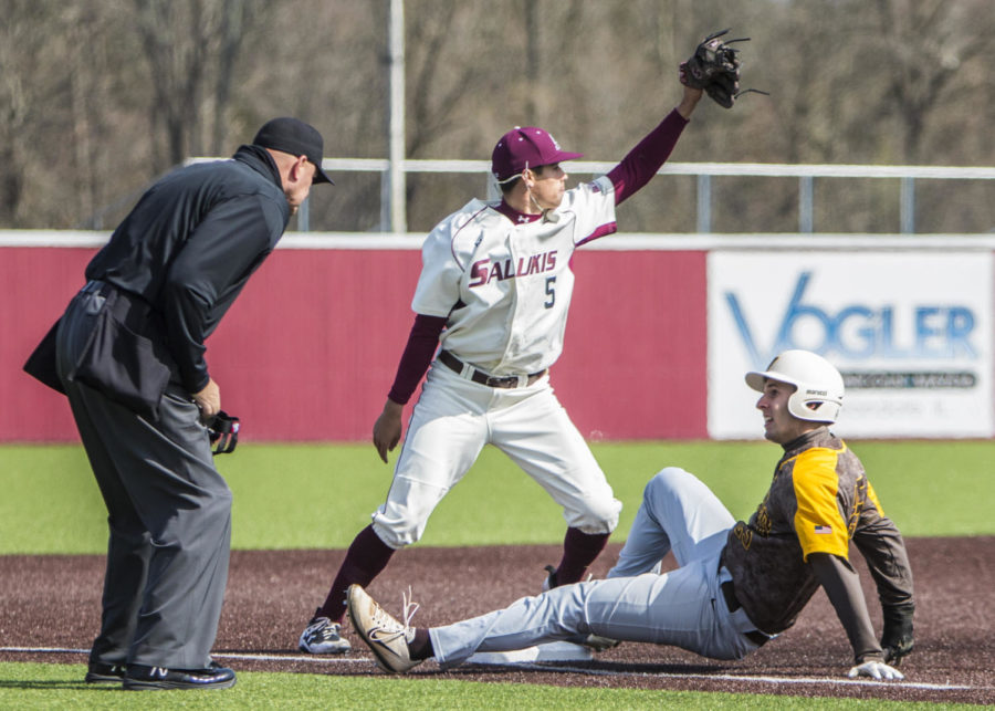 Southern Illinois freshman infielder Grey Epps (5) raises his glove after a play at third base, Saturday, April 7, 2018, during the Valparaiso University Crusaders 6-2 victory against the Southern Illinois Salukis at Itchy Jones Stadium. (Corrin Hunt | @CorrinIHunt)