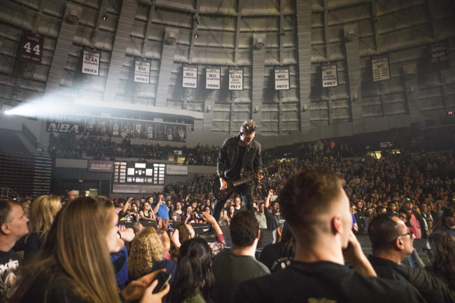 Seth Morrison, a lead guitarist for the band Skillet, plays the guitar in front of the crowd, Thursday, April 26, 2018, during the Skillet and King and Country concert at the Southern Illinois University Arena. (Corrin Hunt   @CorrinIHunt)