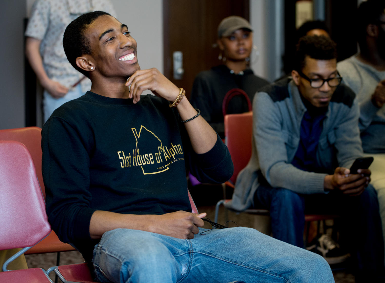 Newly elected Undergraduate Student Government president Toussaint Mitchell, a junior studying cinema from Aurora, reacts as the results of this year's election are announced Wednesday, April 11, 2018, in the Missouri Room of the Student Center. (Brian Munoz | @BrianMMunoz)