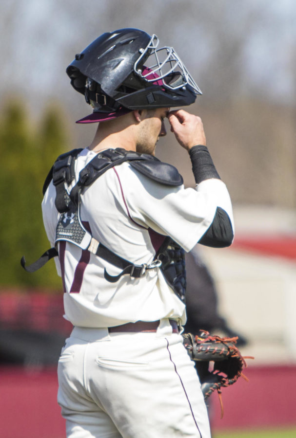 Southern Illinois sophmore catcher Austin Ulick reacts after a player for the Crusaders hit a homerun, Saturday, April 7, 2018, during the Valparaiso University Crusaders 6-2 victory against the Southern Illinois Salukis at Itchy Jones Stadium. (Corrin Hunt   @CorrinIHunt)