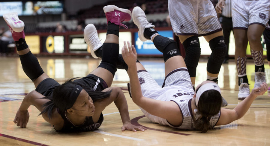Sophomore guard Brittney Patrick and Missouri State guard Liza Fruendt fall after a play Friday, Jan. 26, 2018, during the SalukisÕ 71-69 win over the Missouri State University Bears at SIU Arena. (Reagan Gavin | @RGavin_DE)