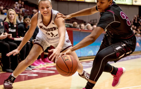 Sophomore forward Nicole Martin fights Missouri State forward Aubrey Buckley for the ball Friday, Jan. 26, 2018, during the SalukisÕ 71-69 win over the Missouri State University Bears at SIU Arena. (Brian Munoz | @BrianMMunoz)