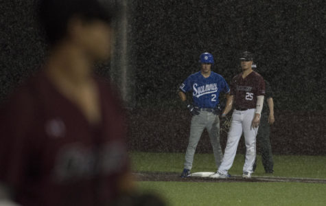 SIU infielder Logan Blackfan and Indiana State infielder Jarrod Watkins watch on as the rain starts to fall Friday, May 4, 2018, during the Salukis' 3-2 win against the Indiana State Sycamores at Itchy Jones Stadium. (Cameron Hupp | @CHupp04)