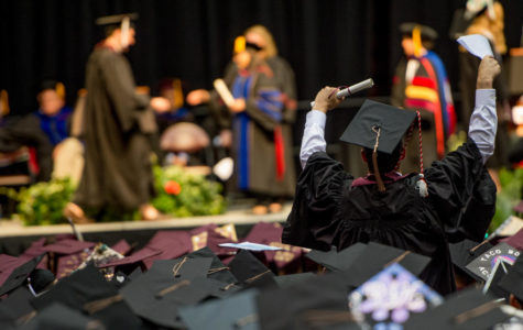 A bachelors degree recipient celebrates on Saturday, May 12, 2018, during the 142nd SIU commencement ceremony in the SIU Arena. (Brian Munoz | @BrianMMunoz)