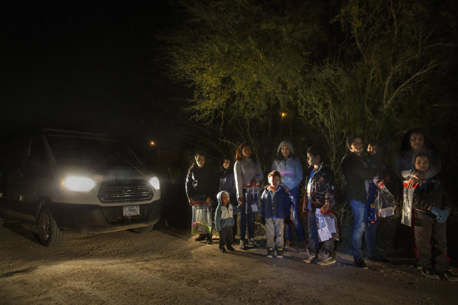 After crossing the Rio Grande River at night with the help of smugglers, a group of mainly women and children from Central America are detained by U.S. Border Patrol agents before being taken into detention on Jan. 27, 2017. (Carolyn Cole/Los Angeles Times/TNS)
