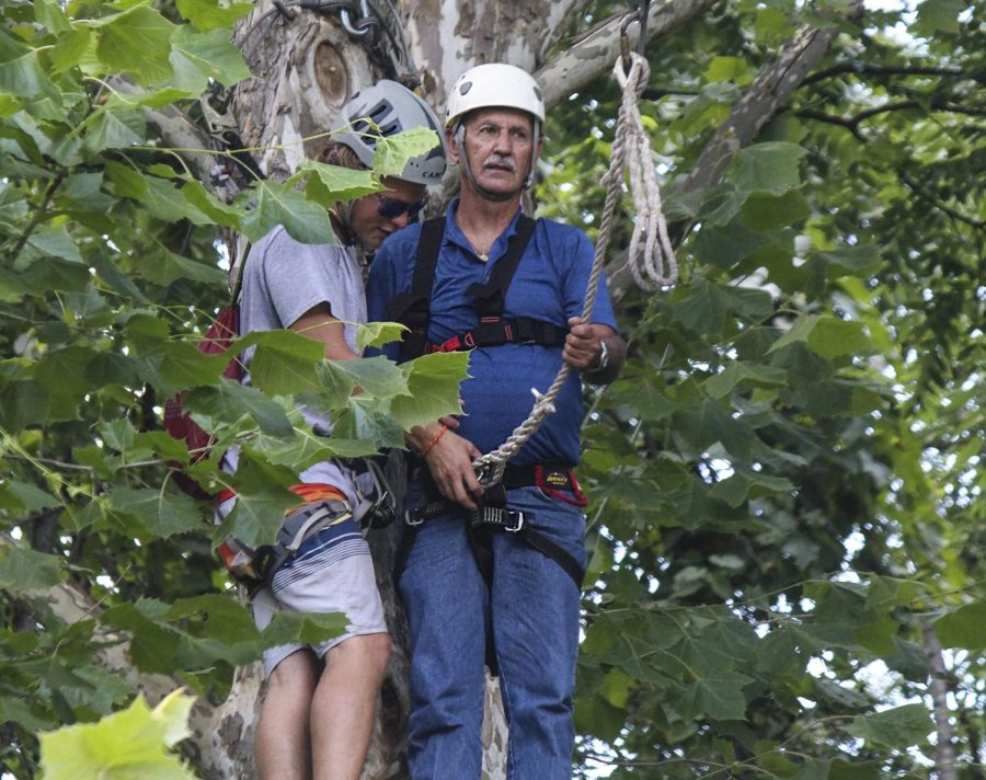 Dennis Burks of Carbondale prepares to go on the zipline, Wednesday, July 4, 2018, during the Veteran's Adeventures at Touch of Nature Environmental Center (Nick Knappenburger)
