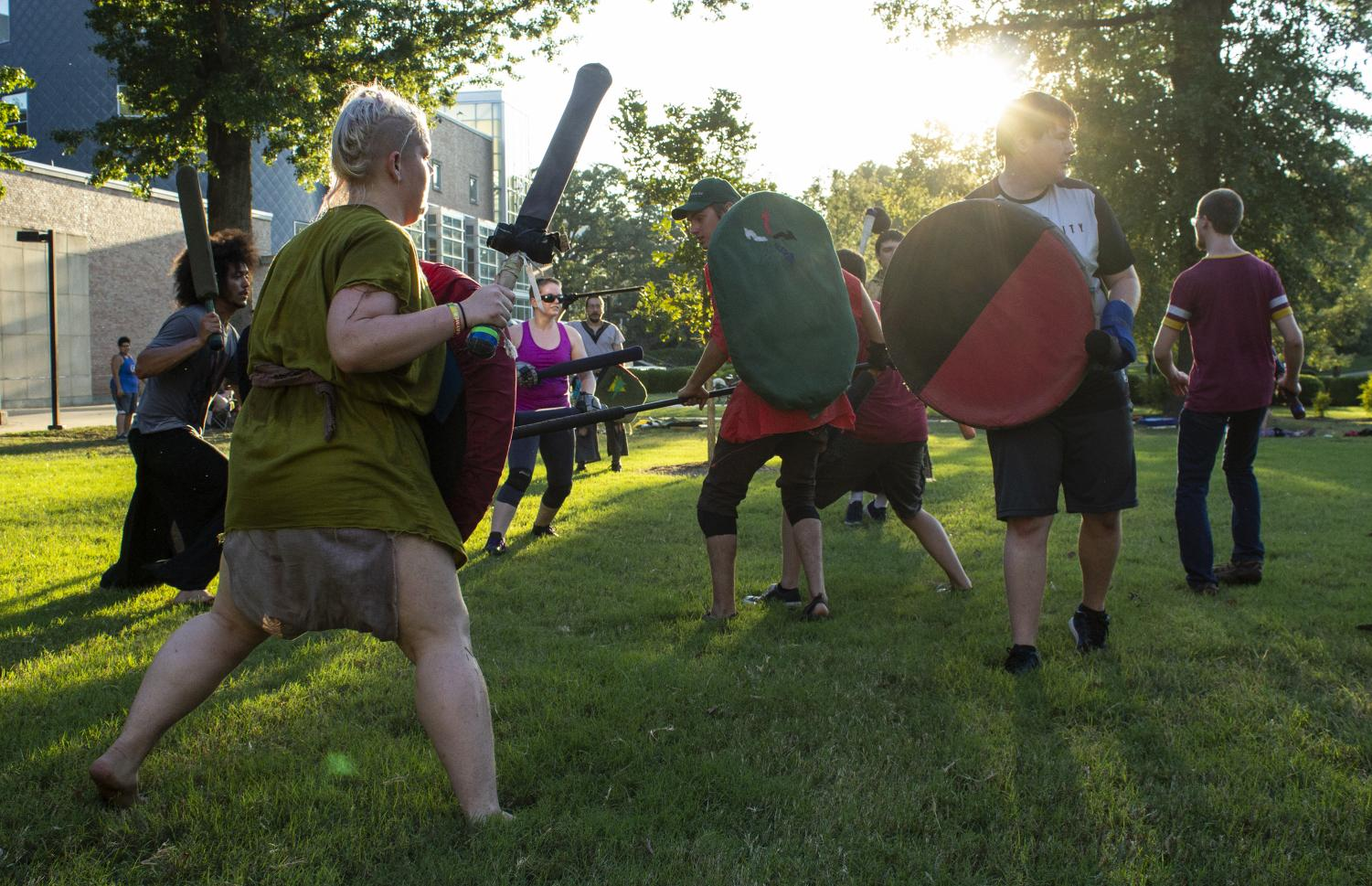 Members of SIU's Medieval Combat Club battle in front of Morris Library, on Tuesday, Sept. 4, 2018. (Carson VanBuskirk | @carsonvanbDE)
