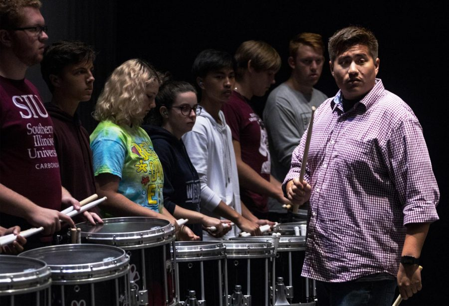 Francisco Perez, a percussion teacher and coordinator at Lamar University, 28, of Beaumont, Texas instructing percussion students on rhythm and grip during the Southern Illinois University music department's Percussion Tune-Up, Saturday, Sept. 8, 2018. (Allie Tiller | @allietiller_de)
