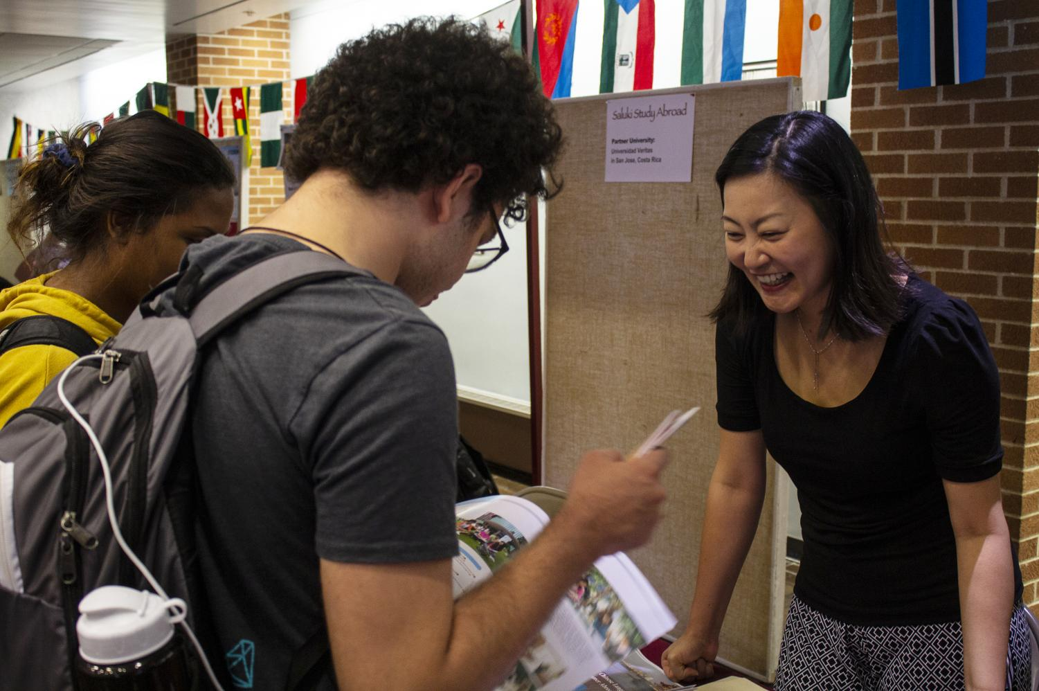 Dr. Shu-Ling Wu (right), 36, of Taiwan, speaks to Andrew Aaflaq (center), 20, of Carbondale, and Destiny Hurd (left), 21, of LaGrange, about her Chinese Language and Culture Program at SIU's Study Abroad Fair Wednesday, Sept. 12, 2018. (Carson VanBuskirk | @carsonvanbDE)
