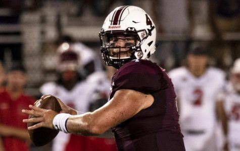 Senior quarterback Sam Straub prepares to throw the football to the receiver, during Southern Illinois University's first home game of the 2018 season, Saturday, Sept. 15, 2018.  (Allie Tiller | @allietiller_de)