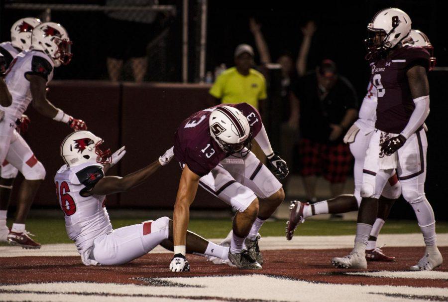 Junior Nigel Kilby of Fort Wayne, Ind. getting up after being tackled in the end zone during Southern Illinois University's game against SEMO, Saturday, Sept. 15, 2018. (Allie Tiller | @allietiller_de)