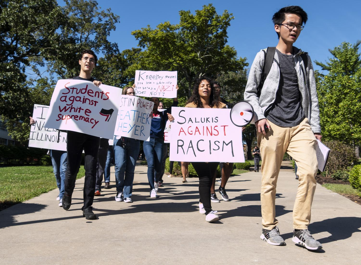 "Zhi Hao ""Eric"" Tsang, 22, of Malaysia, studying marketing, leads the Rally Against Racism around campus. (Carson VanBuskirk 