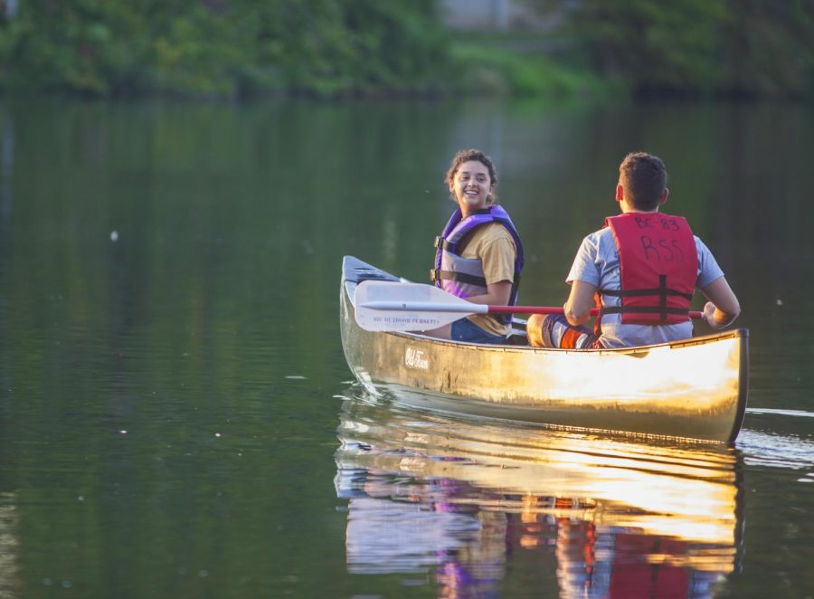 Angelina Capp and Colin Heisler row in a canoe, Sunday, Sept. 30, 2018, at Campus Lake.