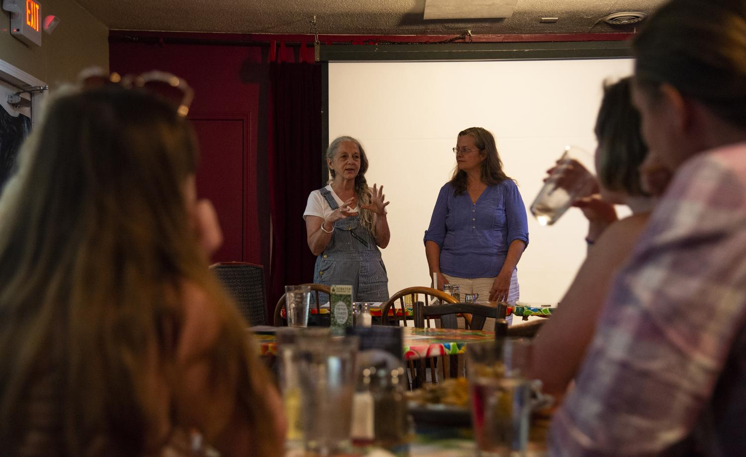 Elaine Ramseyer (left) and Jenn Pellow (right) discuss the sustainable measures their local businesses have adopted Wednesday, Sept. 5, 2018, at the Longbranch Cafe and Bakery in Carbondale. Ramseyer manages the Longbranch Cafe and Pellow manages the Town Square Market both located in Carbondale. (Cameron Hupp)
