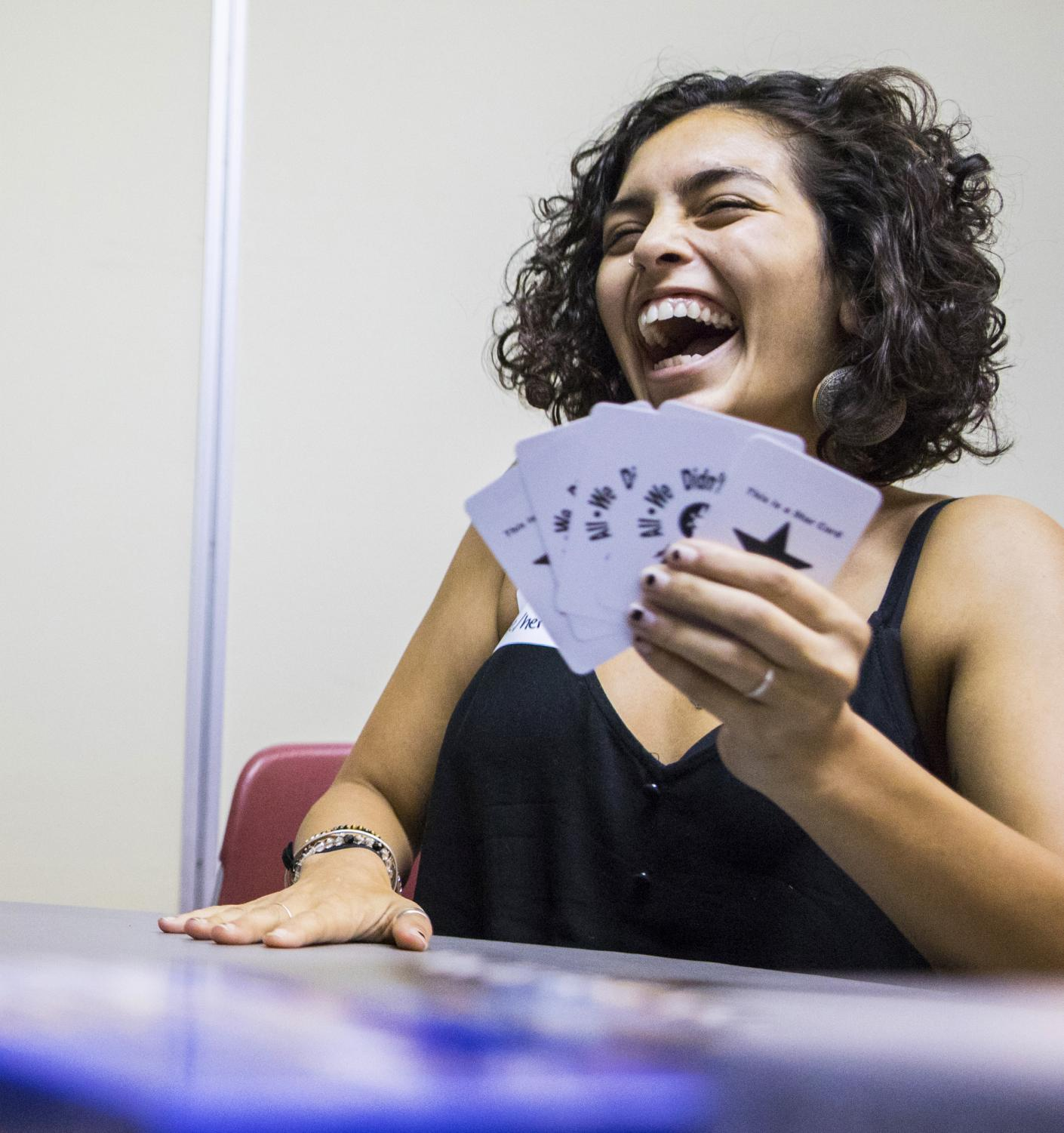 Shayla, a graduate student at SIU, plays a card game Friday, Sept. 14, 2018, after the A.L.I.A.S. RSO meeting at the Student Center. Shayla said she joined the group because it fits in with her lifestyle and sexual identity. (Corrin Hunt | @CorrinlHunt)