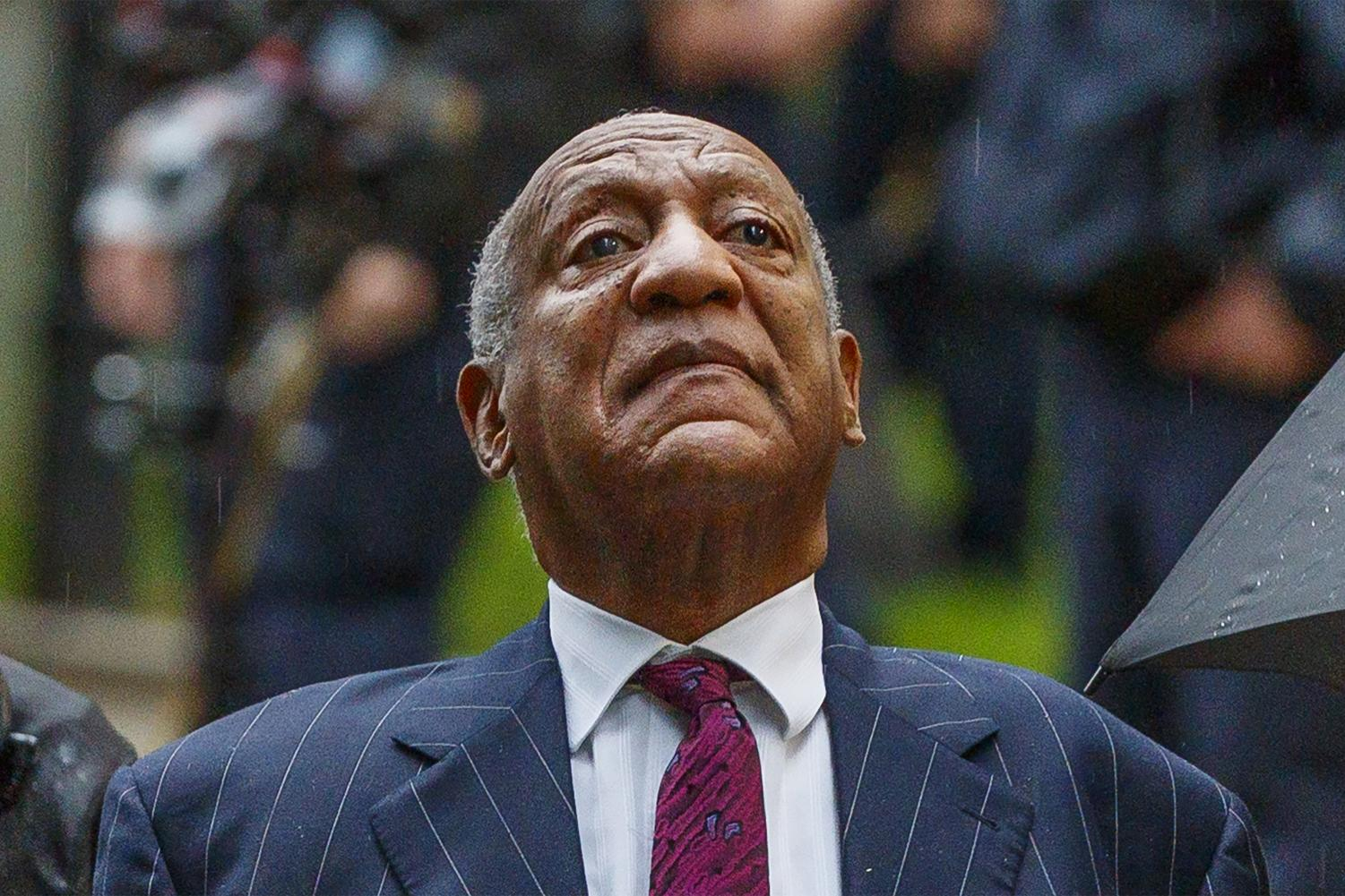 Bill Cosby raises his head toward the sky after a supporter told him to