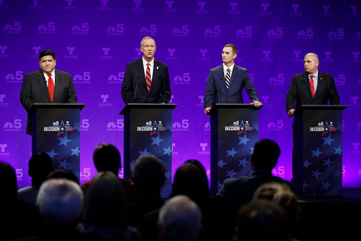 From left, candidate J.B. Pritzker, Illinois Gov. Bruce Rauner, candidate Kash Jackson, and candidate State Sen. Sam McCann attend a televised debate at the NBC studios in Chicago on Thursday, Sept. 20, 2018. (Armando L. Sanchez/Chicago Tribune/TNS)