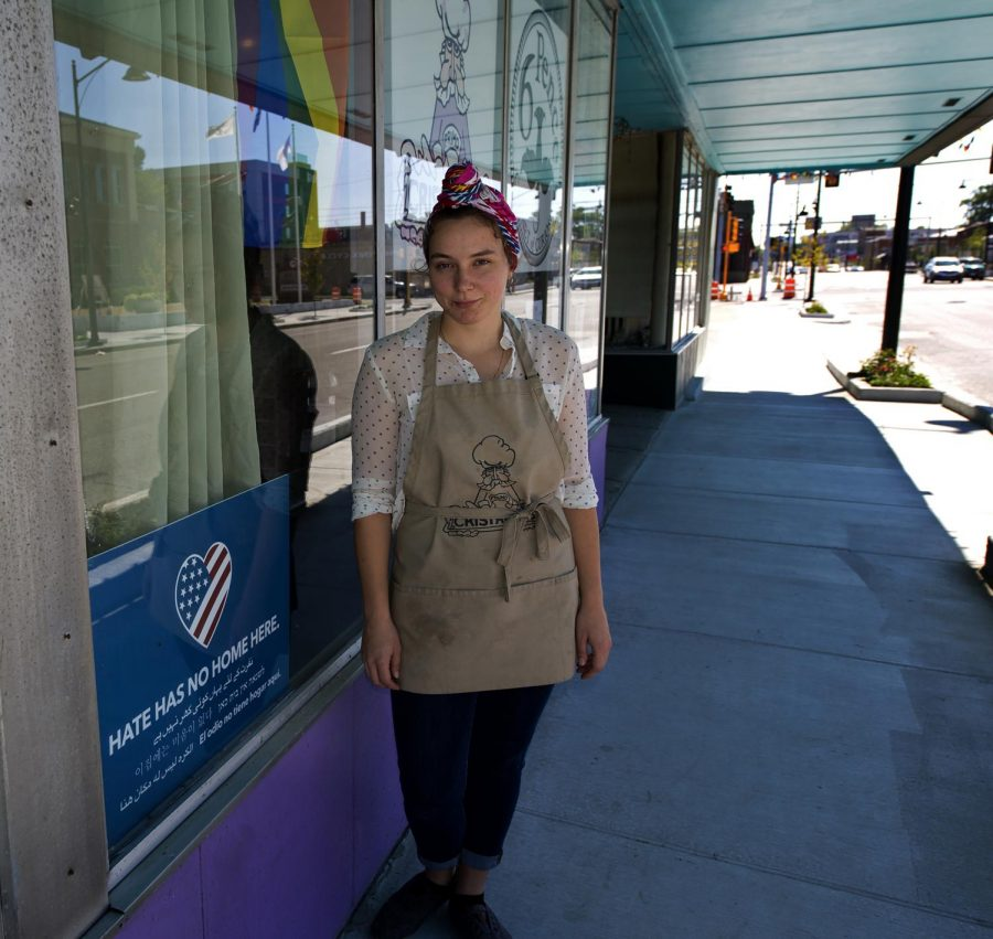 "Kristen Bowe, 22, of Bolingbrook, an employee of Cristaudo's, stands outside of the business on Sunday, Sept. 30, 2018. Cristaudo's has both a ""Hate Has No Home Here"" sign and a pride flag hanging in their front window which indicates a business with an inclusive environment. ""I feel that it's important to have an environment for everyone to feel at home even when they're not,"" Bowe said. (Chase Jordan)"