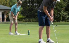 Freshman, Vikar Jonasson (right), of Iceland, and Junior Sean Mullan (left), of England, practice their short game at an SIU Men's Golf practice on Wednesday, Oct. 3, 2018. (Carson VanBuskirk | @carsonvanbDE)