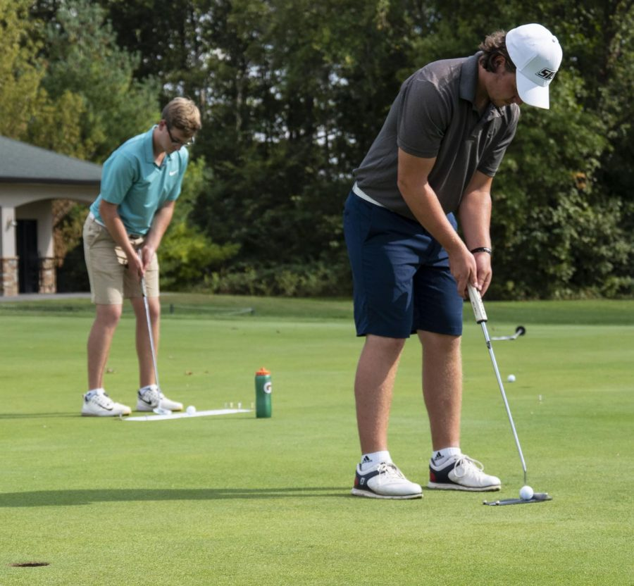 Freshman, Vikar Jonasson (right), of Iceland, and Junior Sean Mullan (left), of England, practice their short game at an SIU Men's Golf practice on Wednesday, Oct. 3, 2018. (Carson VanBuskirk | @carsonvanbDE)