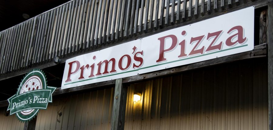The Primos Pizza sign outside of the Carbondale restaurant around sunset on Sunday, Oct. 7, 2018. (Allie Tiller | @allietiller_de)