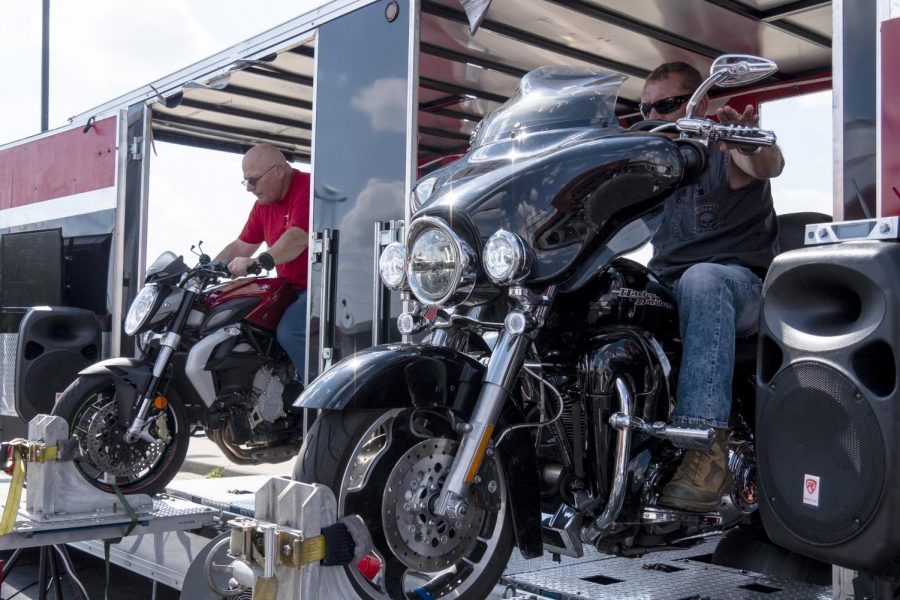 "Frank Bijlsma, left, of Herrin, races Alan Bryan, right, of Pinckneyville, at the All Out Dyno Drag race at Black Diamond Harley-Davidson on Sunday, Oct. 7, 2018. All Out Dyno Drag's owner Scott Frazier said, ""[Dyno Drag racing] is a safe way for guys to get on here, get strapped down, feel safe, and be able to run their bikes as fast as they can possibly run it, without doing it on the streets and taking a chance at having an accident."" (Carson VanBuskirk 